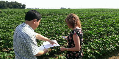 Graduate student working with researcher at AgResearch and Education Center