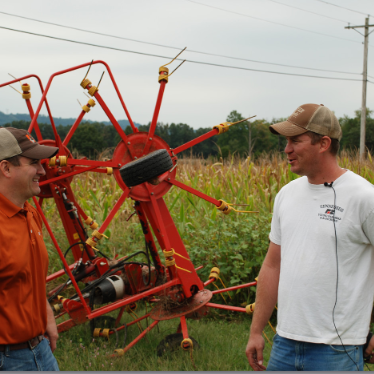 Area Specialist in Farm Management talking to row crop producer